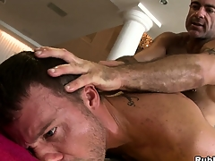 Horny daddy bear shafting a young hunk adjacent to a hot hardcore anal gay video