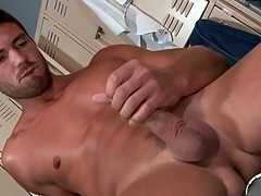Hot bloke strokes his terminated cock beside a vengeance