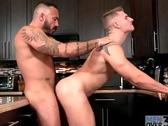 Bear fucks hot young ass over kitchen tap